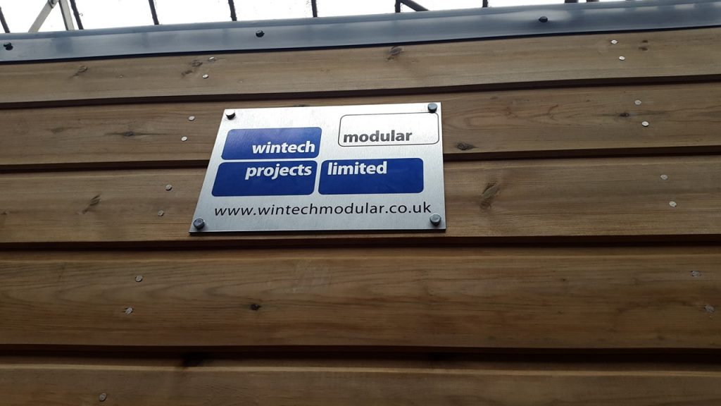Wintech Modular Buildings logo on side of portable washroom
