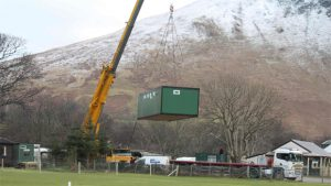 Crane moving portable washroom modular building
