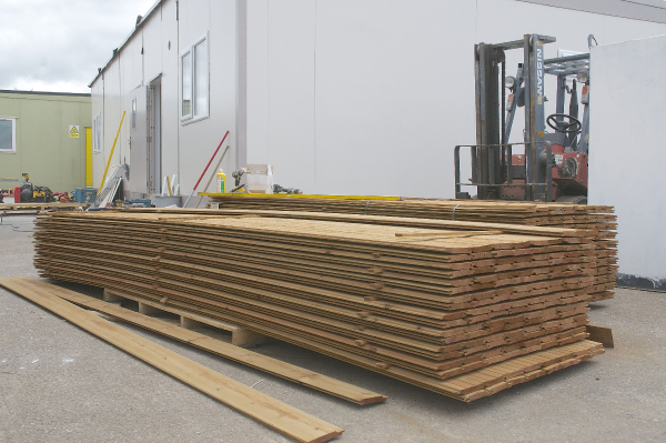Pile of building plank materials