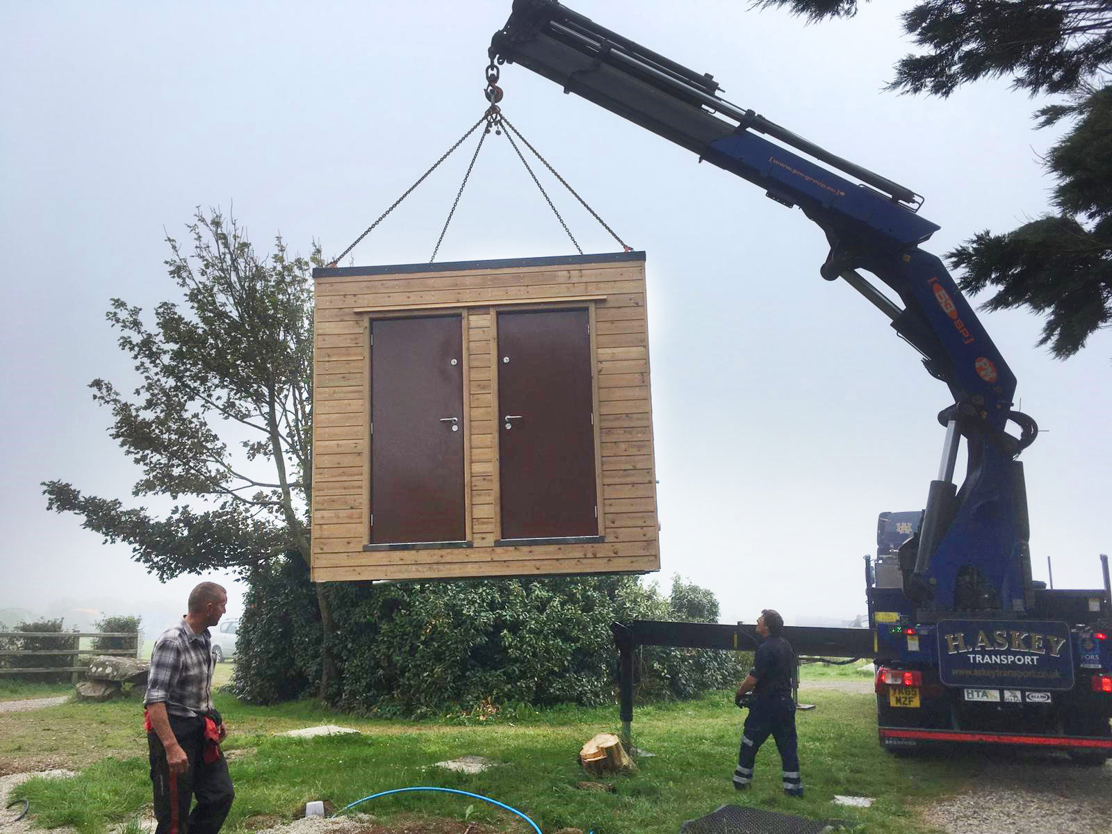 installation on a campsite of a portable toilet block
