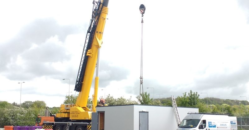 Modular building being installed at a site