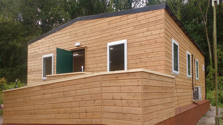 Timber clad hut with a disabled access ramp